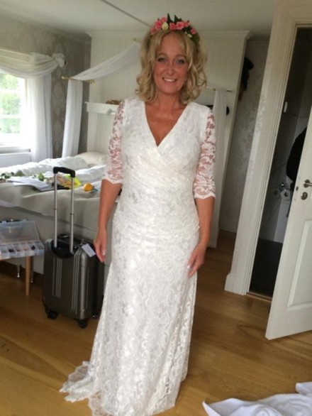 Pamela Anderson in wedding dress made at Camille Thulin Studio.