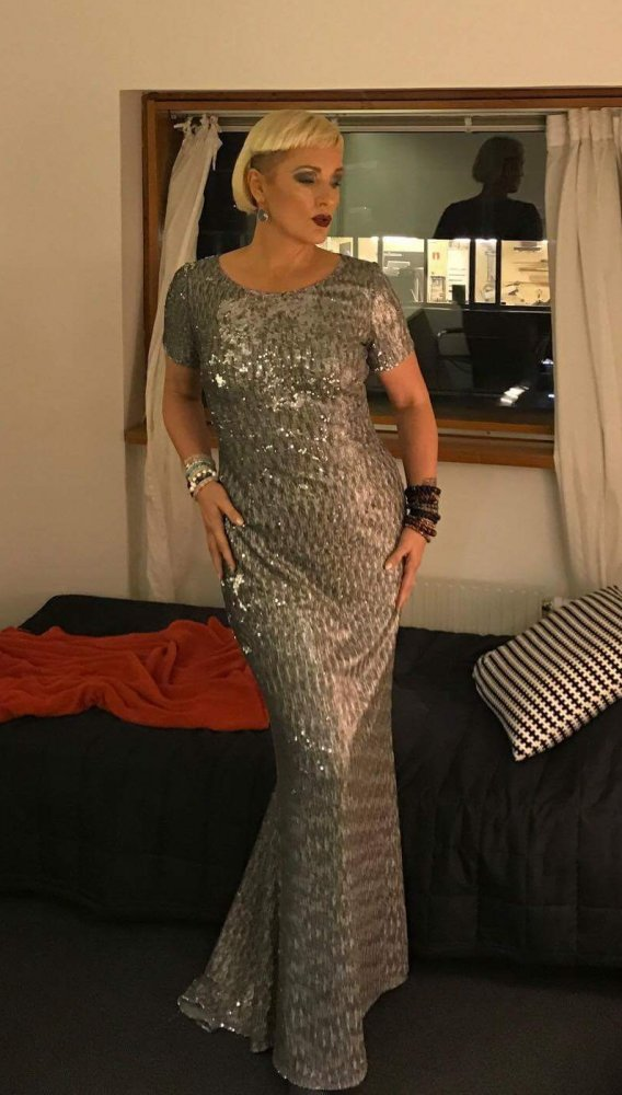 Regina Lund wears a silver sequin dress from Camilla Thulin Design