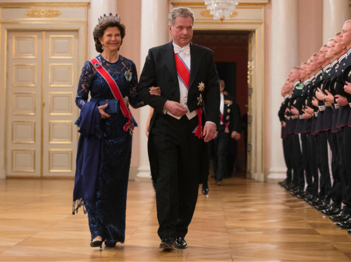 Queen Silvia in a blue sequin dress made by Camilla Thulin Créateur